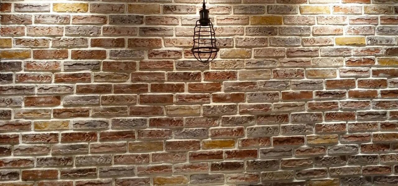 Fasade exposed brick wall work